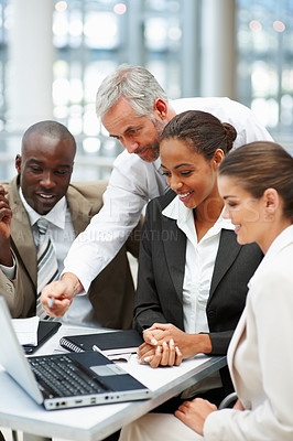 Buy stock photo Confident team of business colleagues working on a laptop