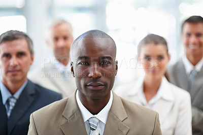 Buy stock photo An African American business man with team at the back