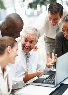 Buy stock photo Happy group of business people enjoying themselves while working on a laptop