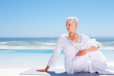 Buy stock photo Old woman relaxing on the sea shore