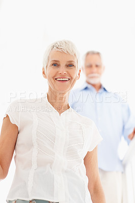 Buy stock photo Cheerful senior woman with husband at the background
