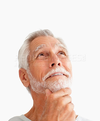 Buy stock photo Mature man looking upwards and thinking, isolated on white
