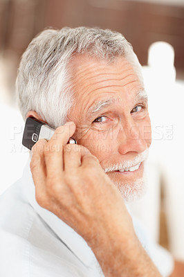 Buy stock photo Portrait of a senior cheerful man enjoying his conversation on mobile