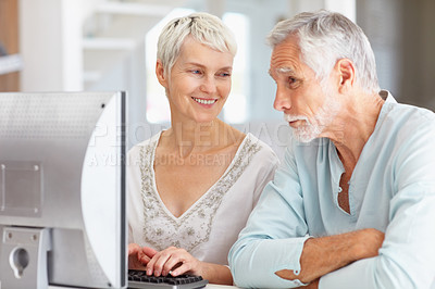 Buy stock photo Senior couple working on a computer together