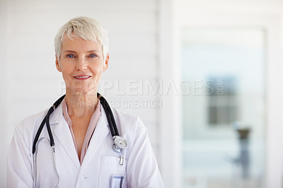 Buy stock photo Portrait of a successful old female doctor smiling confidently
