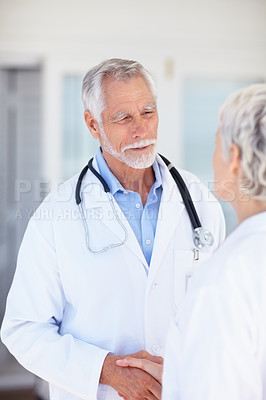 Buy stock photo Image of two successful old doctors communicating with each other