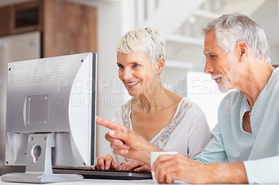 Buy stock photo Elderly man assisting wife to learn computers
