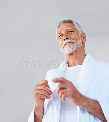 Buy stock photo Image of a senior old happy man holding a cup of tea and smiling