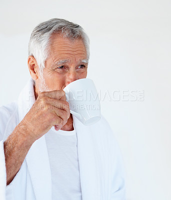 Buy stock photo Portrait of a handsome old man drinking tea and looking towards copyspace