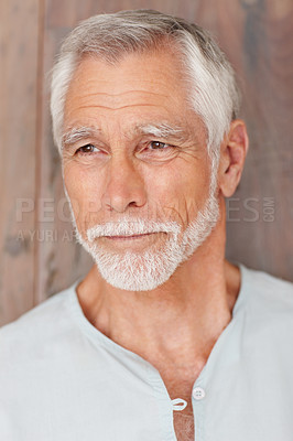 Buy stock photo Portrait of an elderly man looking away over a wooden background