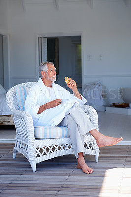 Buy stock photo Old man sitting on a chair, looking away and contemplating