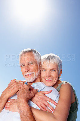 Buy stock photo Portrait of an old woman with her arms around her husband, outdoors