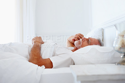 Buy stock photo Portrait of a senior man taking a nap on his bed