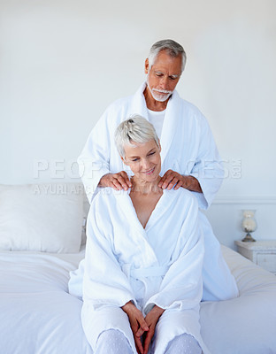 Buy stock photo Portrait of a man giving a shoulder massage to his wife