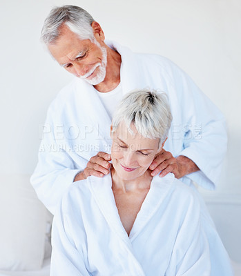 Buy stock photo Loving husband giving a massage to his wife