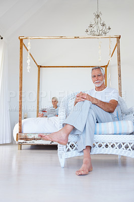 Buy stock photo A senior old retired man relaxing with wife at the back