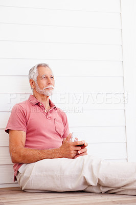 Buy stock photo Old man contemplating while having a glass of wine
