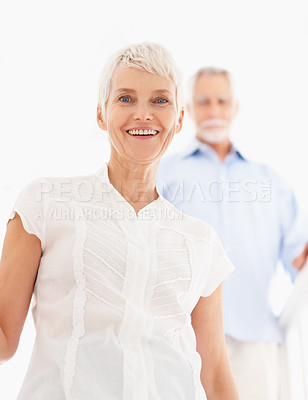 Buy stock photo Charming old woman with her husband in the background