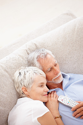 Buy stock photo Old couple relaxing while watching television
