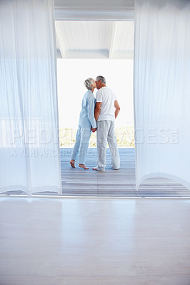 Buy stock photo Rear view of a mature woman kissing her husband