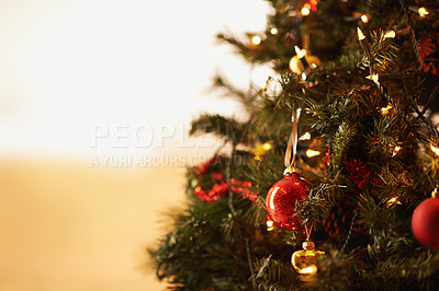 Buy stock photo Cropped shot of ornaments hanging on the christmas tree