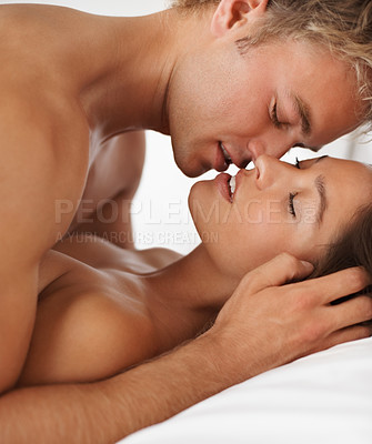 Buy stock photo Head and shoulders image of a passionate young couple in bed having sex