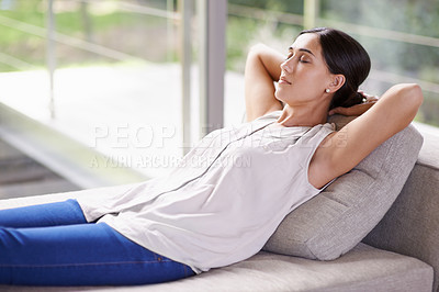 Buy stock photo Shot of a young woman napping on a sofa