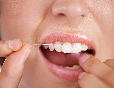 Buy stock photo Closeup shot of a young woman flossing her teeth
