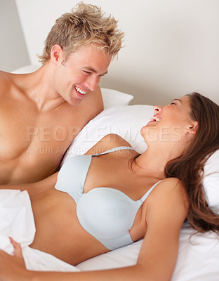 Buy stock photo Young intimate couple having fun in bed
