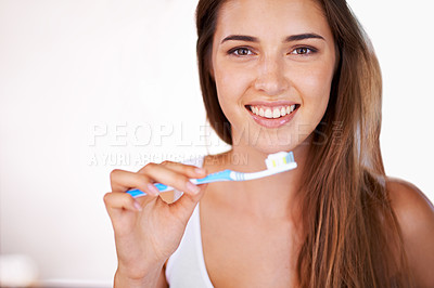 Buy stock photo Cropped shot of a young, pretty girl brushing her teeth