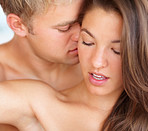 Foreplay: Young married couple enjoying together