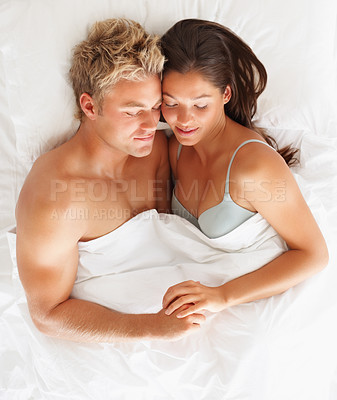 Buy stock photo Top view of a happy young couple sleeping together in bed