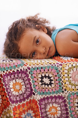 Buy stock photo Portrait of an adorable little girl lying down