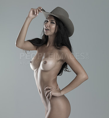 Buy stock photo Studio shot of an attractive semi-clad young woman in a cowboy clothing