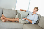 A smart man relaxing on a sofa