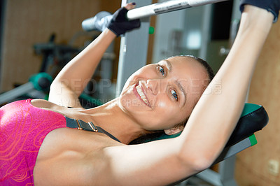 Buy stock photo Portrait of an attractive young woman doing weight training in the gym