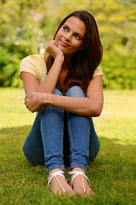 Buy stock photo A beautiful brunette smiling at the camera while spending time outside