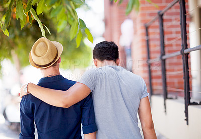 Buy stock photo Shot of a young gay couple walking outdoors