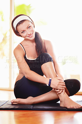 Buy stock photo Portrait of an attractive young woman in sportswear sitting on an exercise mat