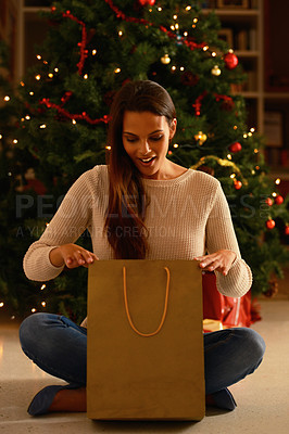Buy stock photo A young woman in front of a Christmas tree