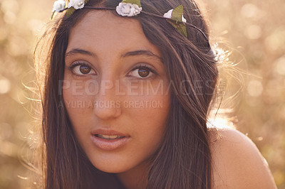 Buy stock photo Cropped portrait of a brunette hippie sitting outdoors