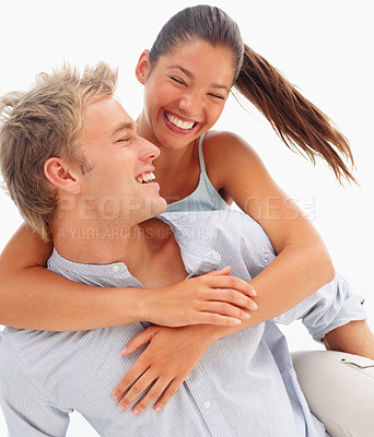 Buy stock photo Portrait of a couple smiling over a white background - piggyback