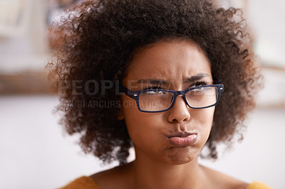 Buy stock photo Cropped shot of an attractive young woman pouting jokingly while looking away