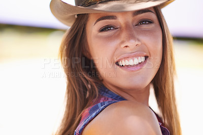 Buy stock photo A portrait of a beautiful young cowgirl outdoors