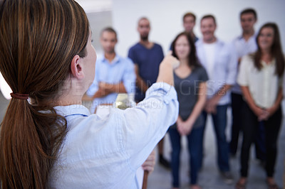 Buy stock photo Shot of a young woman selecting coworkers