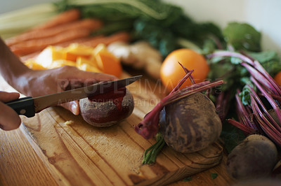 Buy stock photo Cropped shot of a woman slicing fruit and vegetables on a chopping board