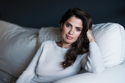 Buy stock photo Portrait of a beautiful young woman relaxing on her sofa at home