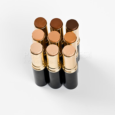 Buy stock photo Shot of several lipsticks arranged by shade