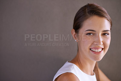 Buy stock photo A beautiful young woman standing in a studio
