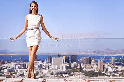 Buy stock photo Panoramic shot of a young businesswoman overlooking the city